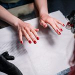 person-with-red-manicure-3997397