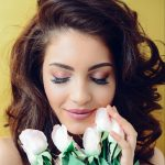 photography-of-a-woman-holding-white-flowers-931004